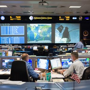 PHOTO DATE: 05-13-09 LOCATION: Bldg. 30 south , WFCR & Backrooms SUBJECT: STS-125 Flight Controllers on Console During HST Grapple - Orbit 1 - Bldg. 30 south.  Flight Director: Tony Ceccacci PHOTOGRAPHER:  JAMES BLAIR