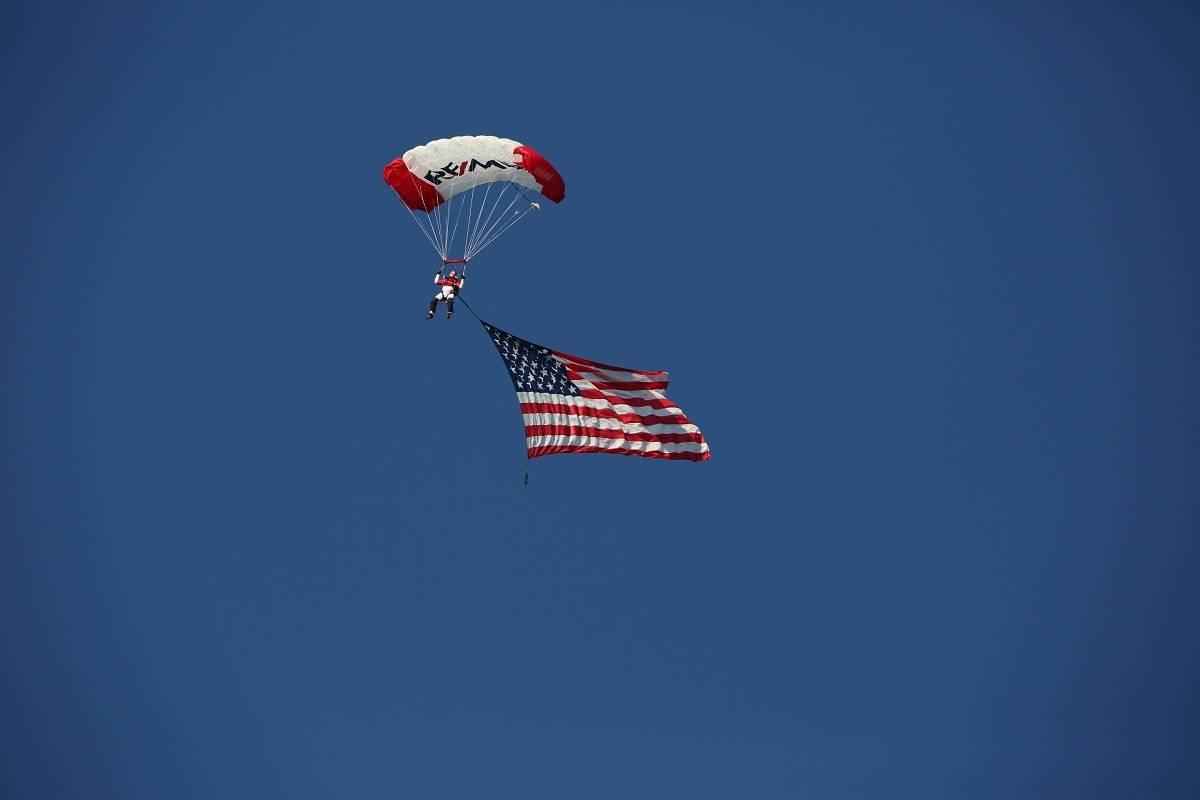 RE/MAX skydivers carried American Flag