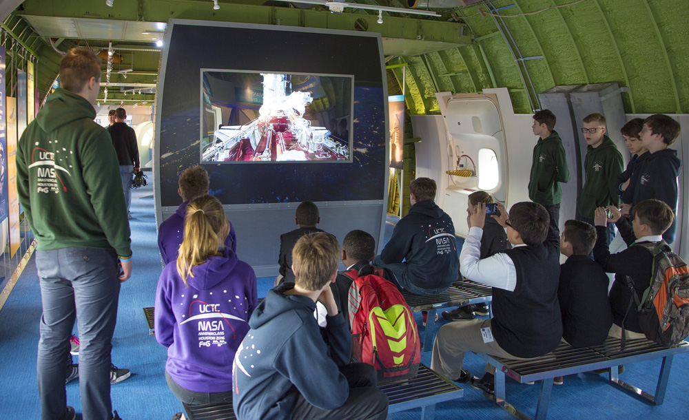 UK students watch a video inside the shuttle carrier aircraft