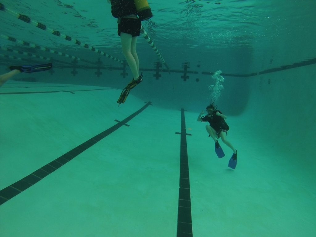 A student shows off underwater