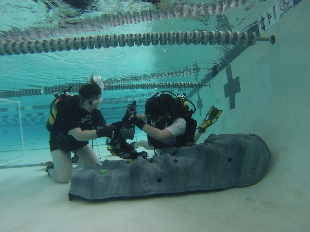 Students perform similar training exercises to NASA astronauts in the pool