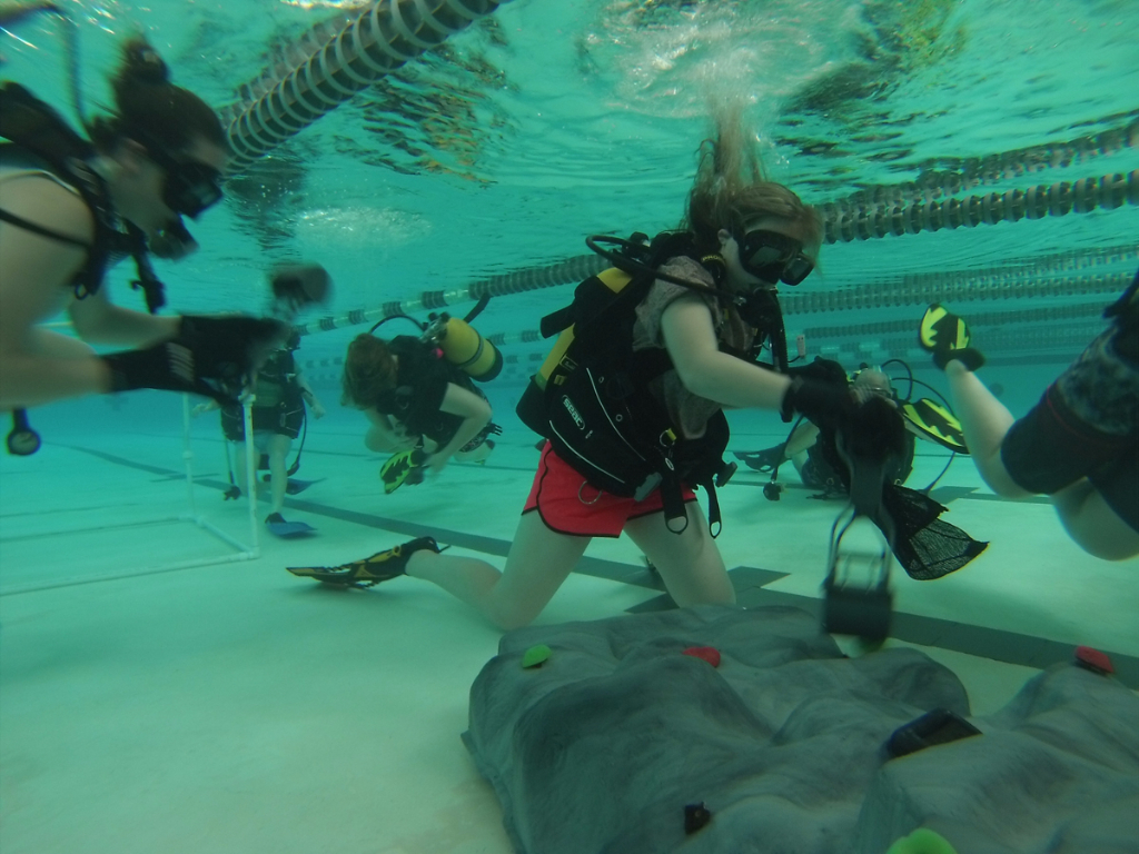Students working underwater