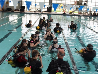 Students perform a final check of their Scuba gear before descending