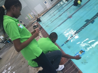 Students deploy a training tool into the pool