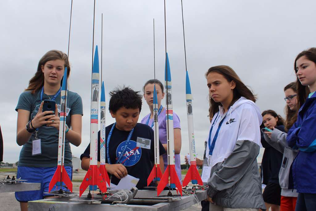 Students do a final check of their rockets prior to liftoff