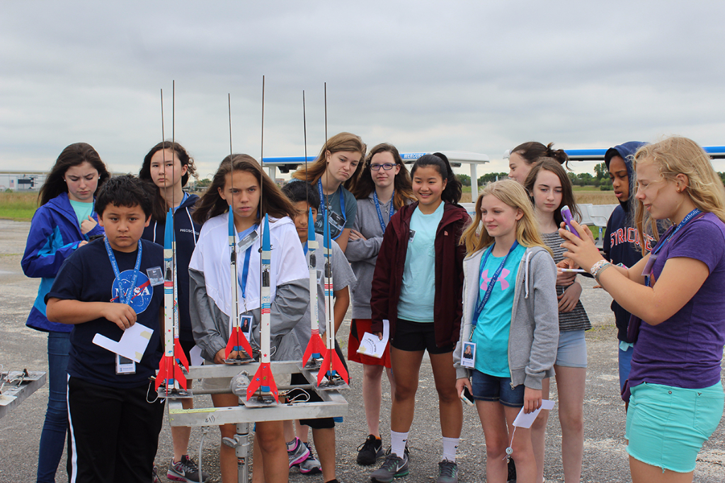 A Space Center U group prepares for their rocket launch