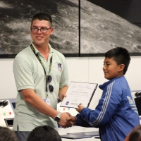 Student receives his Space Center U certificate