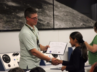 Student receives her Space Center U certificate