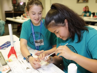 Students work together to build a rocket