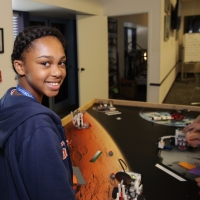 A Space Center U student tests out her robot