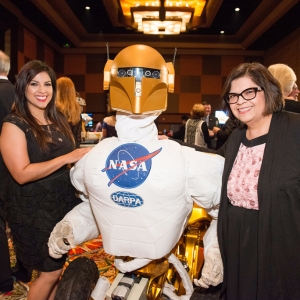 Guests stand next to Robonaut 1 at the 2017 Galaxy Gala.
