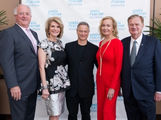 Gary Sinise stops for a photo with VIP guests at the 2017 Galaxy Gala.