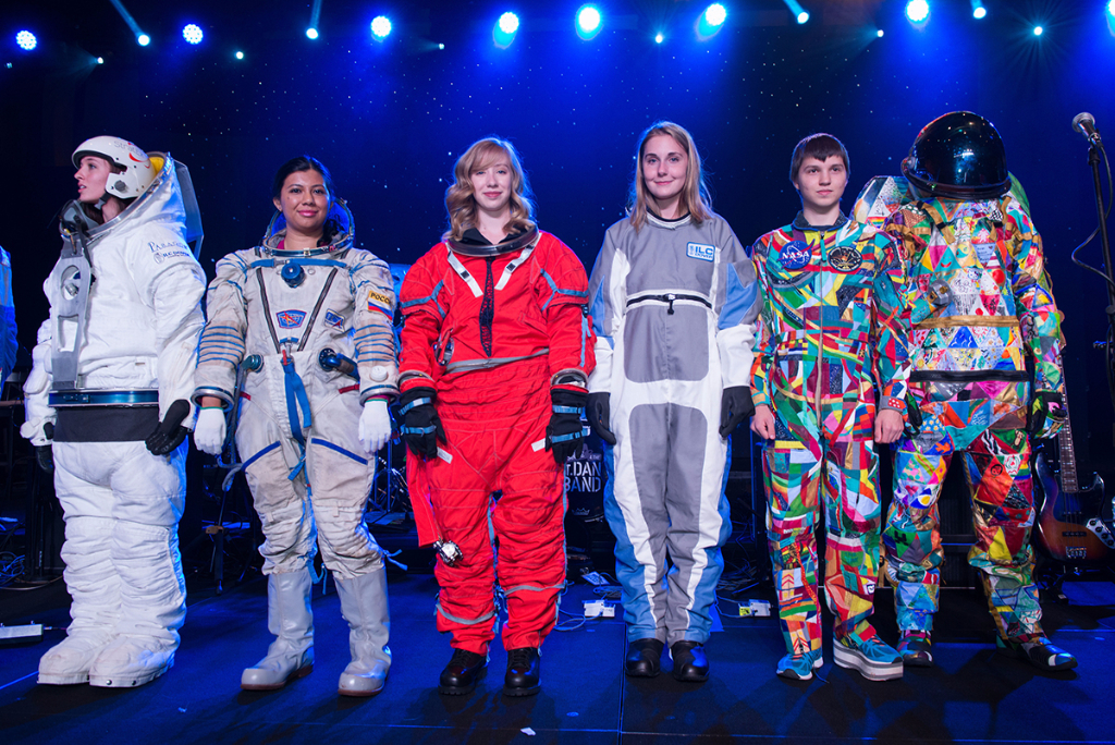 Spacesuits are modeled on stage during the 2017 Galaxy Gala.