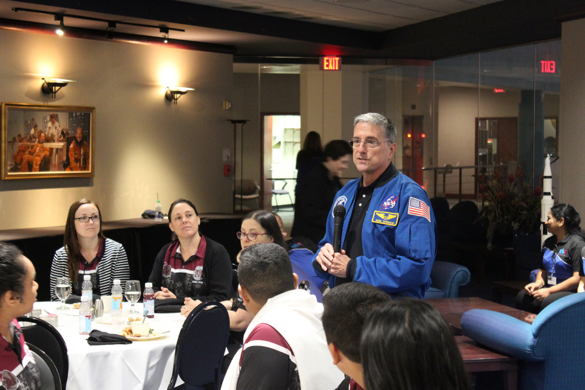 Students enjoy brunch while hearing an astronaut share stories from space.