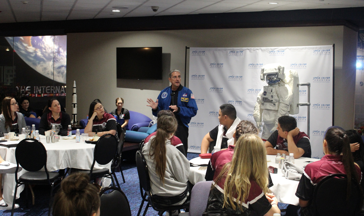 Students hear from an astronaut while enjoying a delicious brunch at the center
