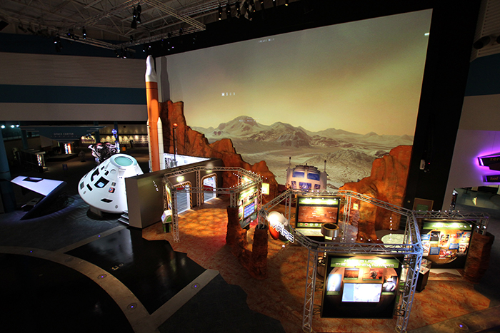 A view of the Mission Mars exhibit, which mimics a red Martian landscape.