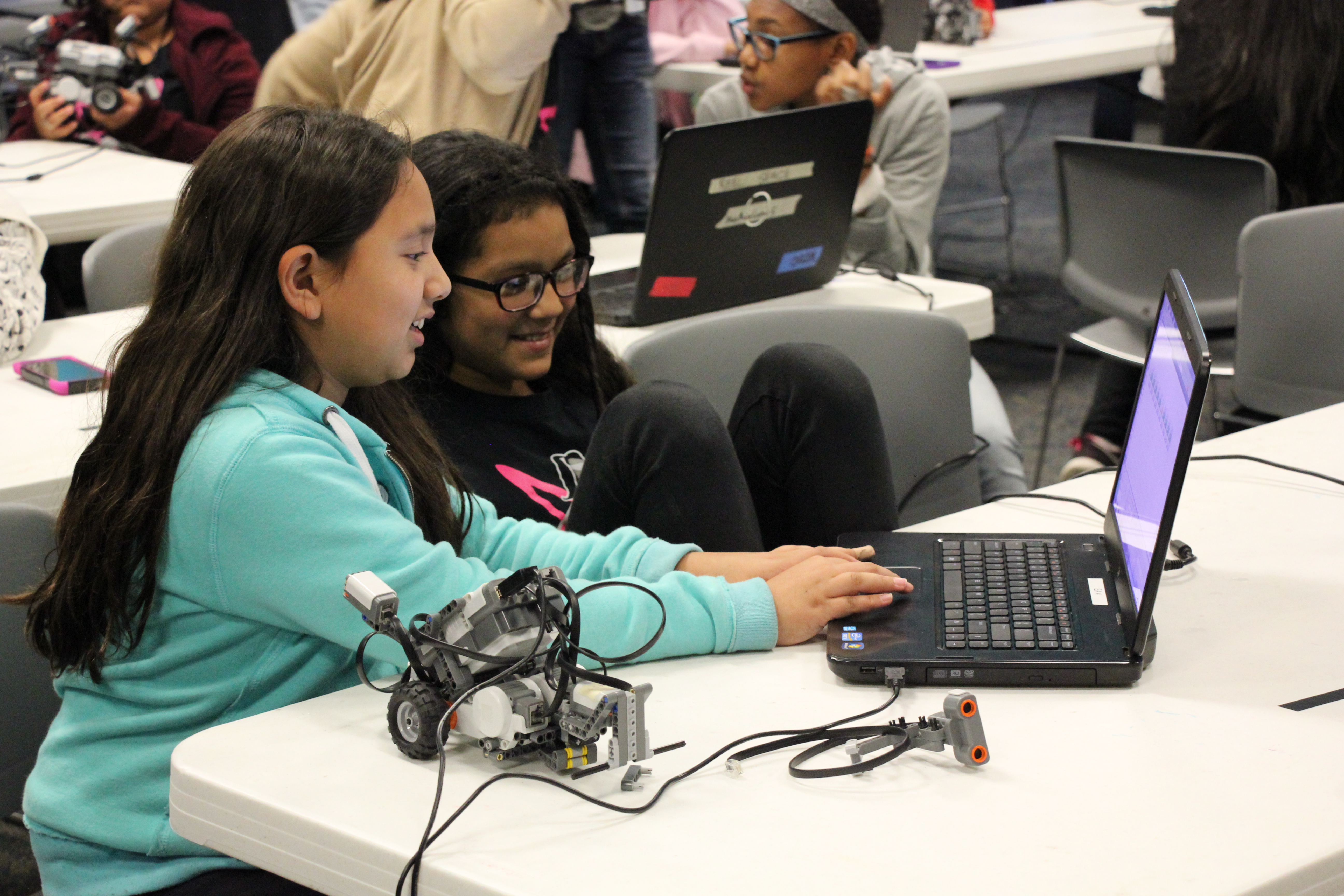 Girls STEM Academy students learn about coding and robotics.