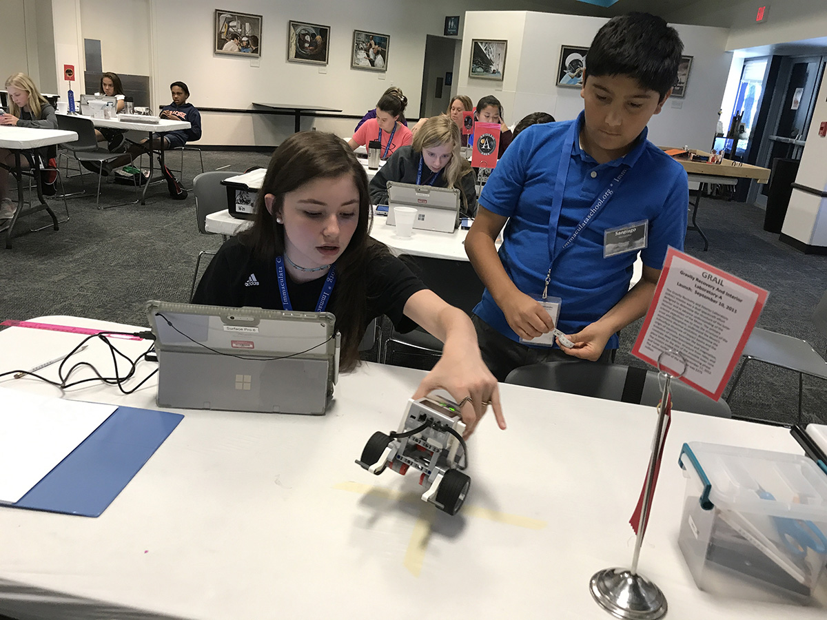 Students learn about coding and robotics at a FIRST® LEGO® League Camp-In