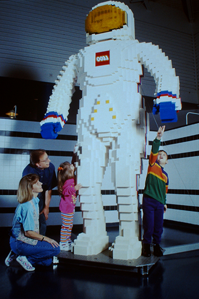 Guests look at a large LEGO astronaut