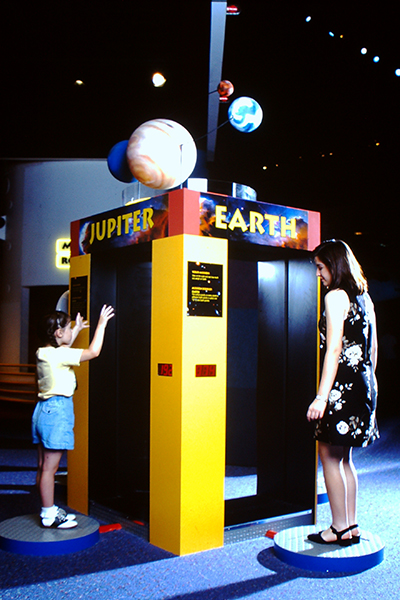 Guests check their weight on different planets