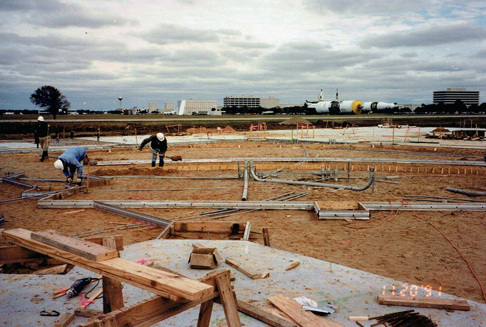 Construction of Space Center Houston with JSC in the background