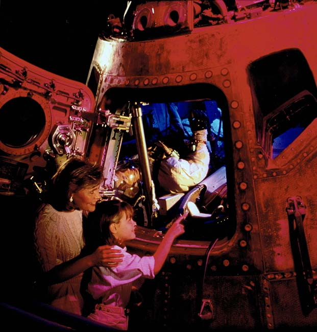 Visitors peer into the Apollo 17 command module