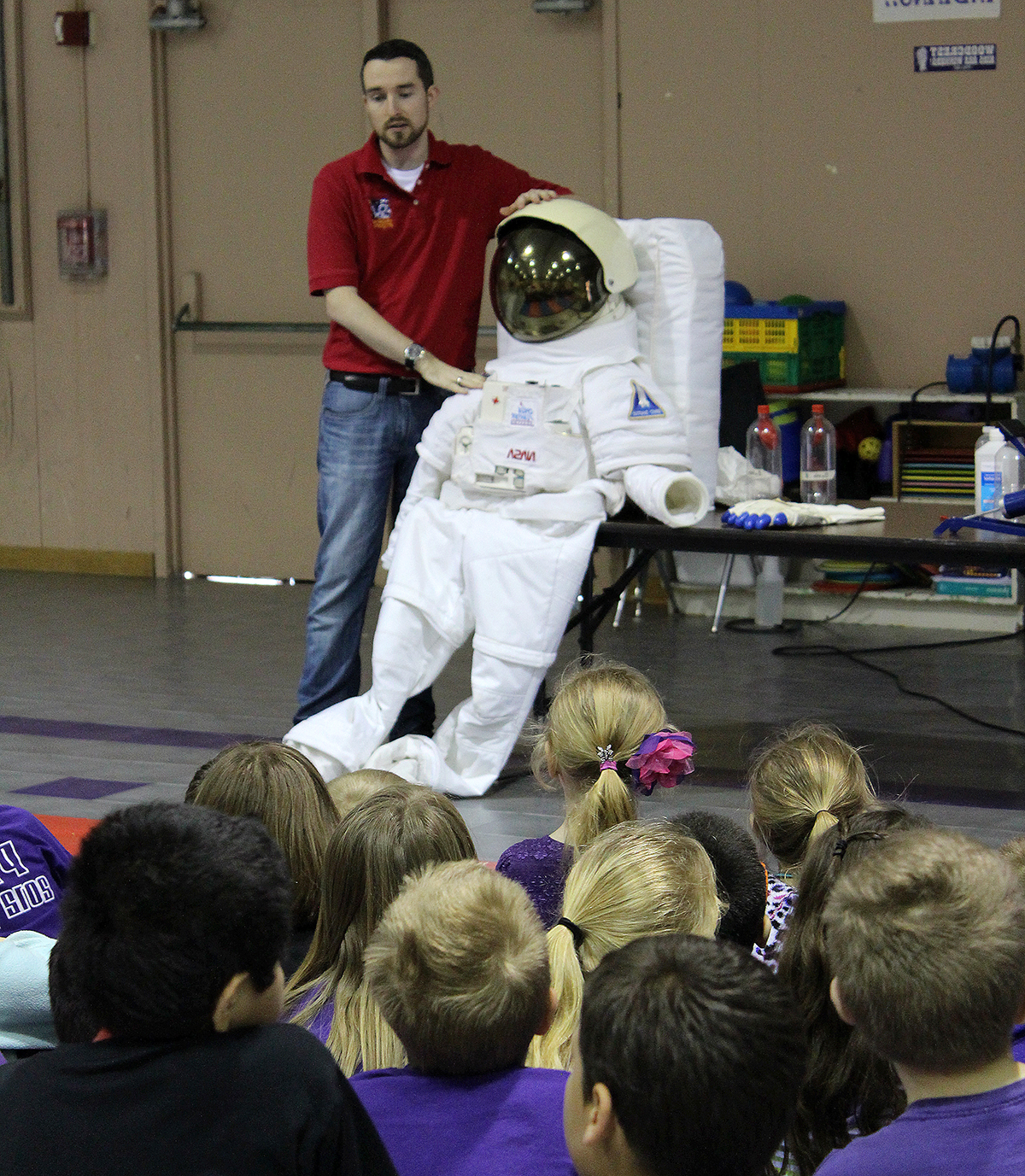 Students listen to a Space Center Houston educator present on space and STEM.