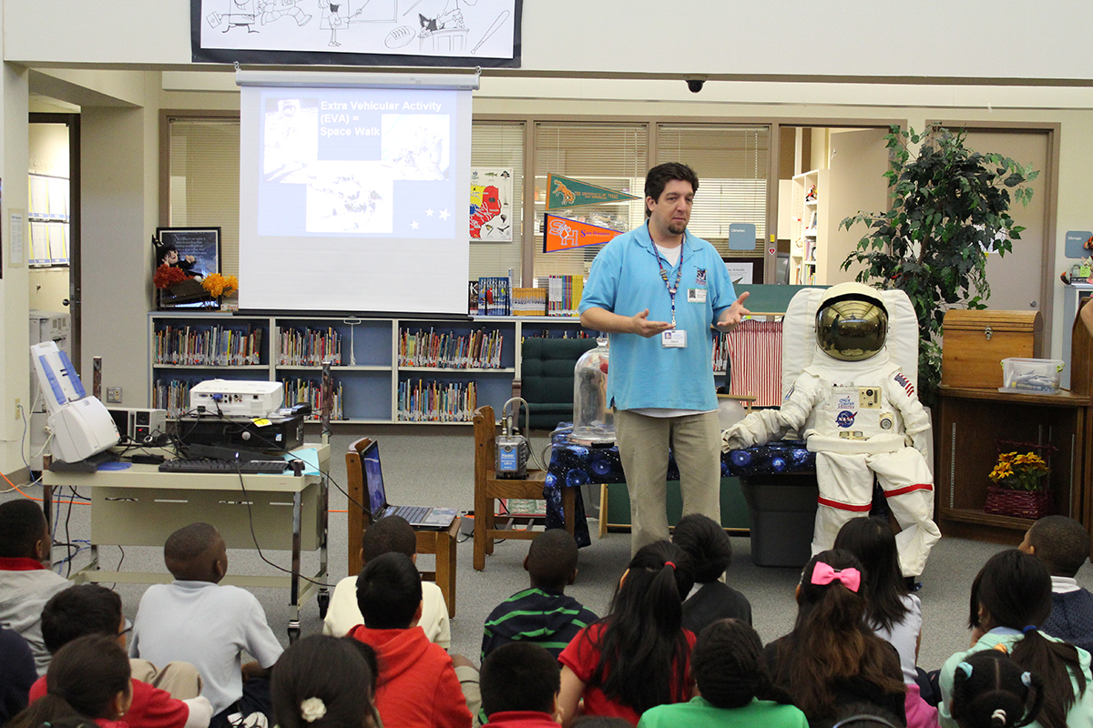 Space Center Houston educator presents to a group of students in their classroom.