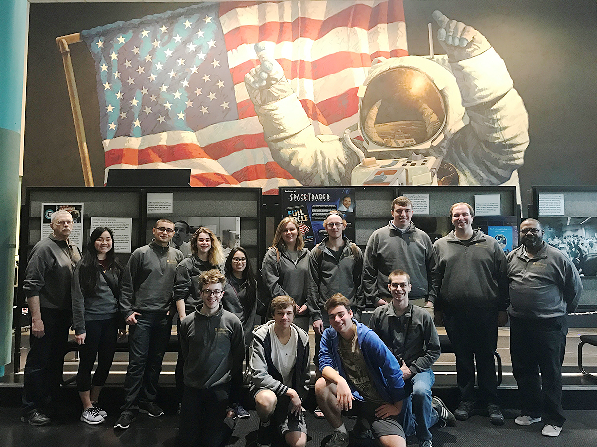 Group of students pose for photo before touring NASA Johnson Space Center.