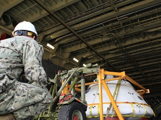 Orion boilerplate test vehicle is loaded into the USS Anchorage.