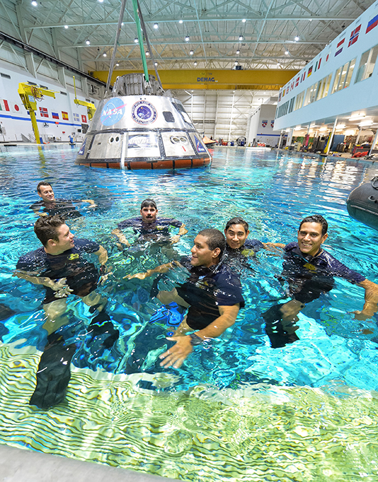U.S. Navy divers training in the Neutral Buoyancy Laboratory at JSC.