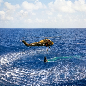 Astronaut Alan B. Shepard Jr. is rescued by a U.S. Marine helicopter.