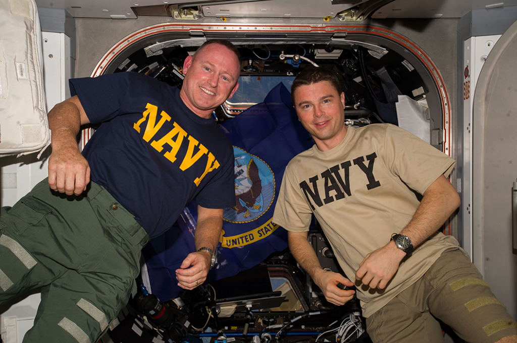 Navy astronauts during Expedition 41 pose for photo aboard the ISS.