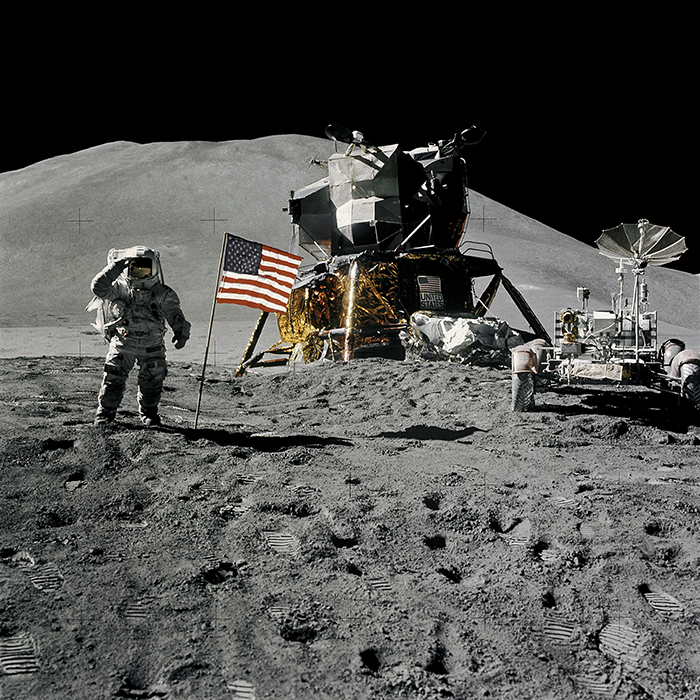 Astronaut James B. Irwin gives a military salute from the surface of the moon with Apollo 15.