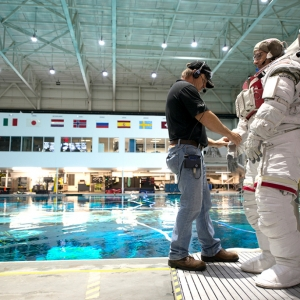 Mark Vande Hei, a retired Army colonel, prepares to train inside NASA's Neutral Buoyancy Laboratory pool.