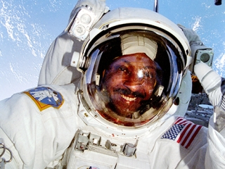 Astronaut Winston E. Scott  during an EVA.