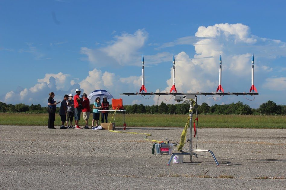 Student-built rockets ready for launch near Rocket Park.