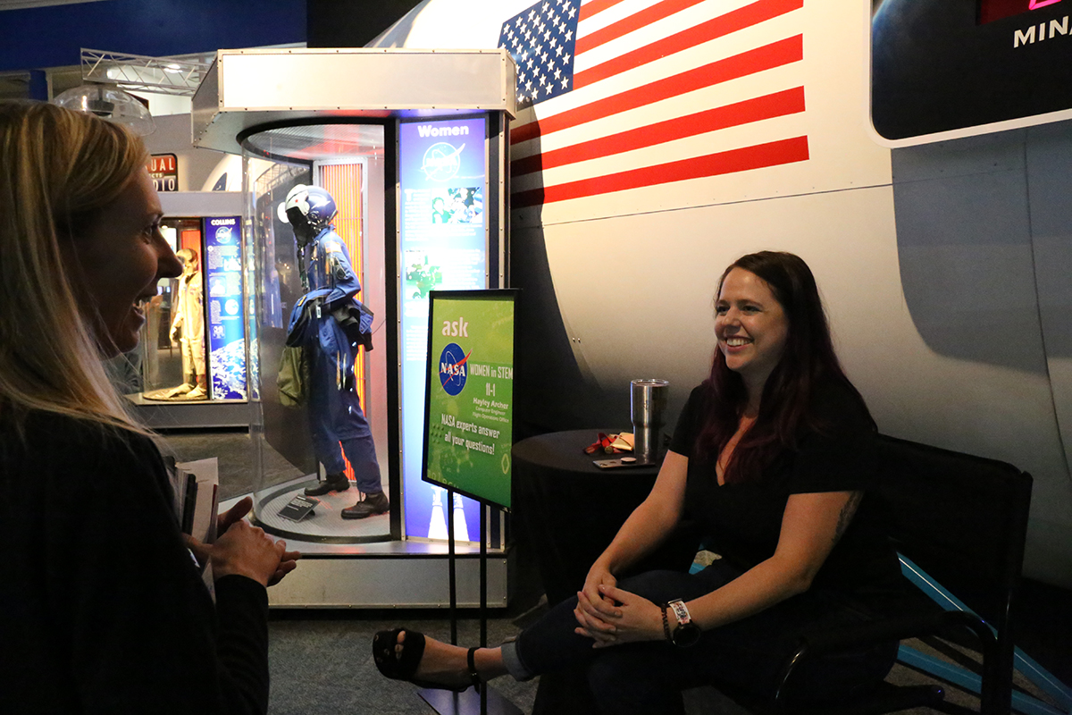 NASA experts answer visitor's questions in the center