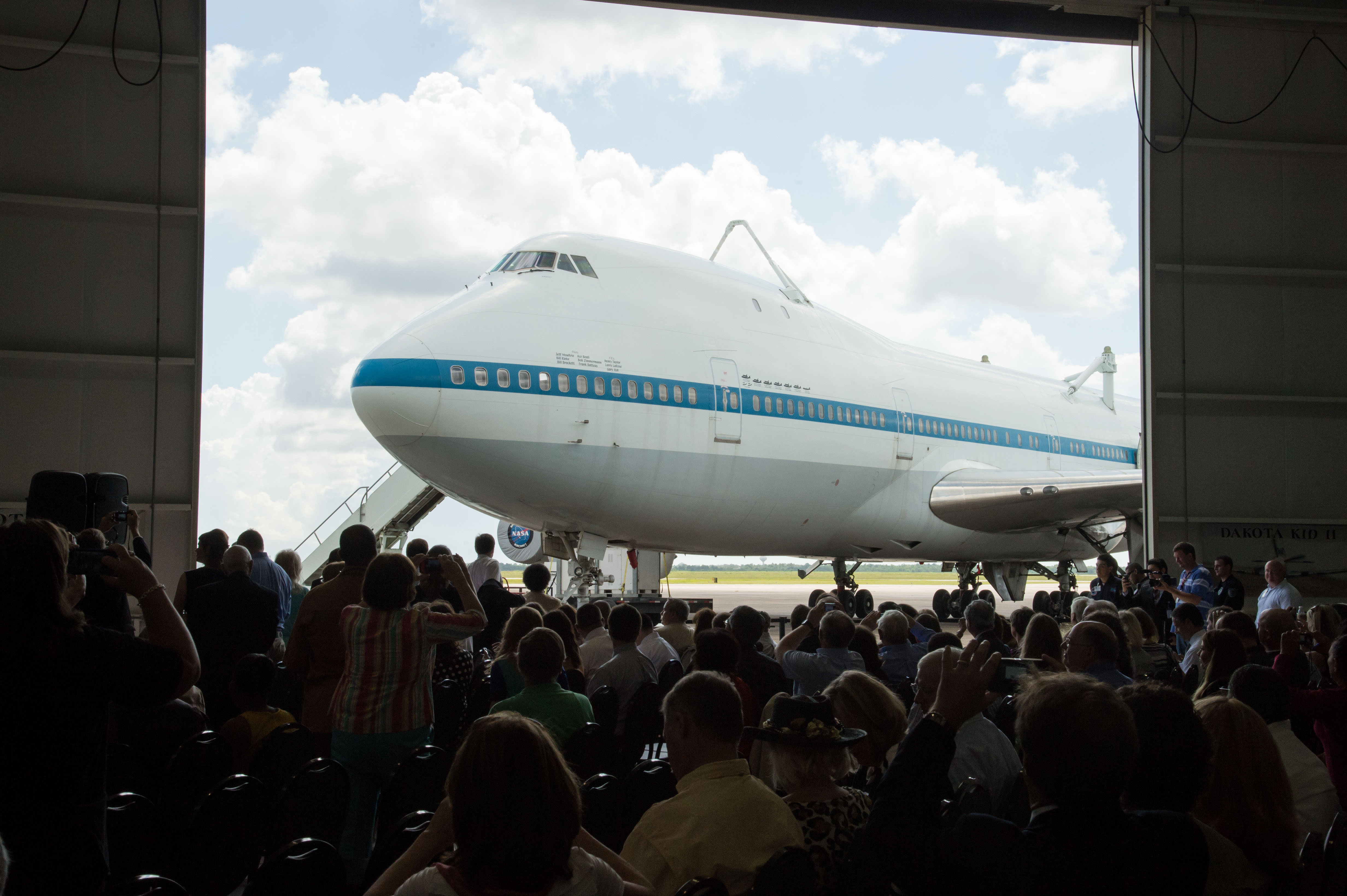 A crowd gathered to witness the arrival of the shuttle carrier aircraft