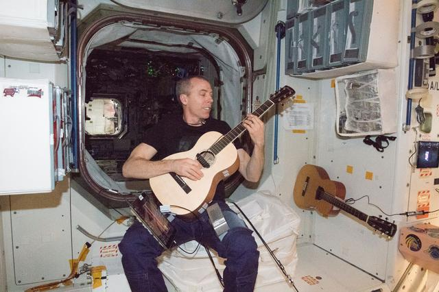 Drew Feustel plays guitar aboard the ISS.