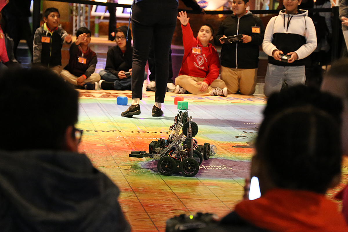 Vex robot on Mars map with children