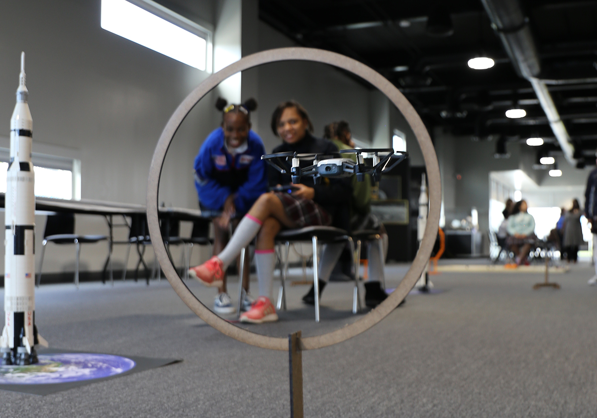 Girls STEM Academy students learn about mission roles and operating drones