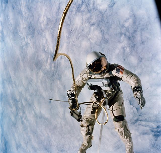 Ed White floats weightless in space during the first American spacewalk