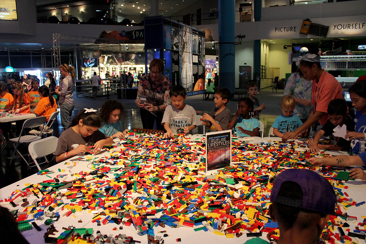 Guests building objects with LEGO bricks at a Pop-Up Science Lab