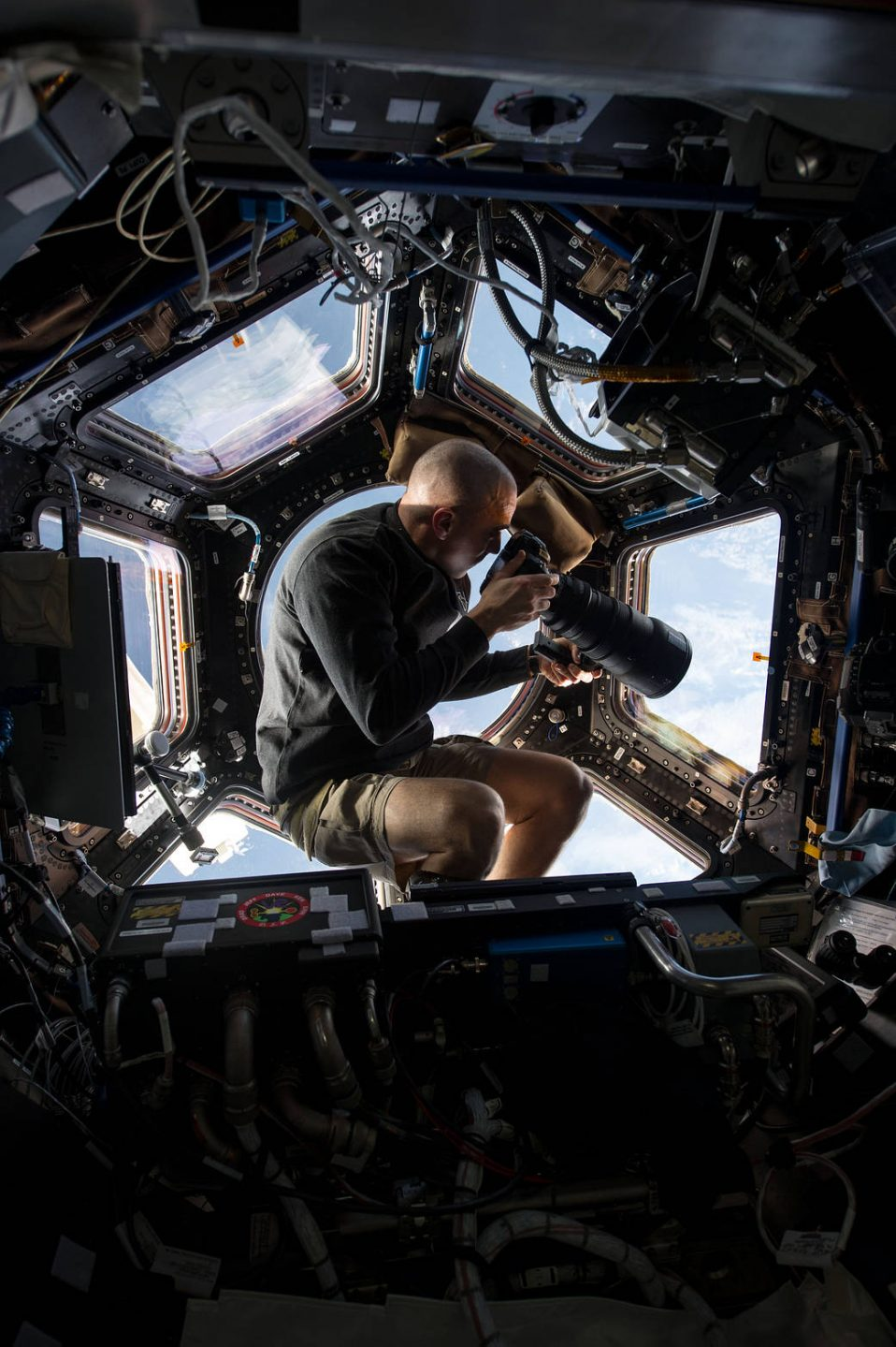 Chris Cassidy takes photographs of the Earth from inside the cupola.