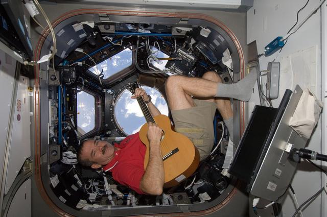 Canadian astronaut Chris Hadfield plays guitar in the cupola.