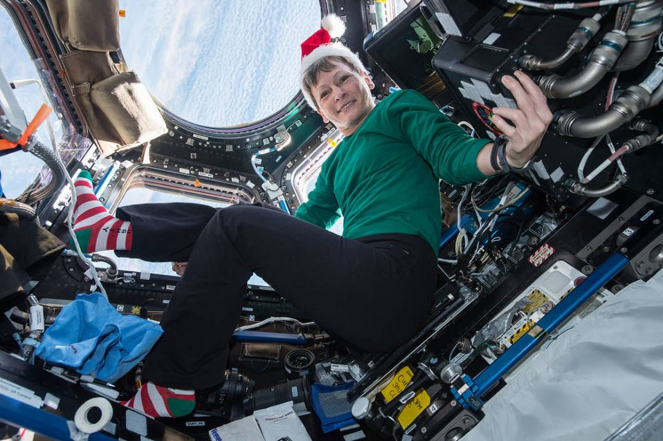 Peggy Whitson sends holiday greetings from inside the cupola onboard the ISS.