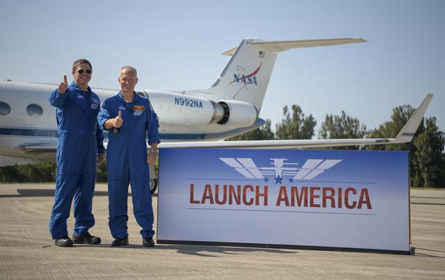 Behnken and Hurley give a thumbs up to the cameras for Launch America