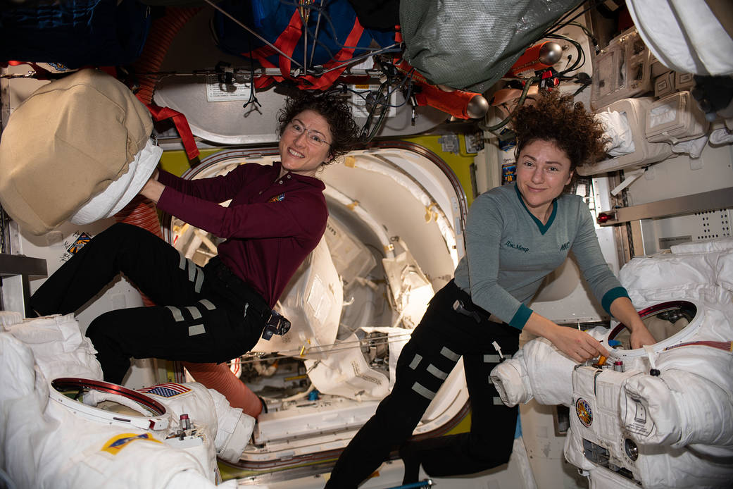 Meir and Koch work on spacesuits aboard the ISS