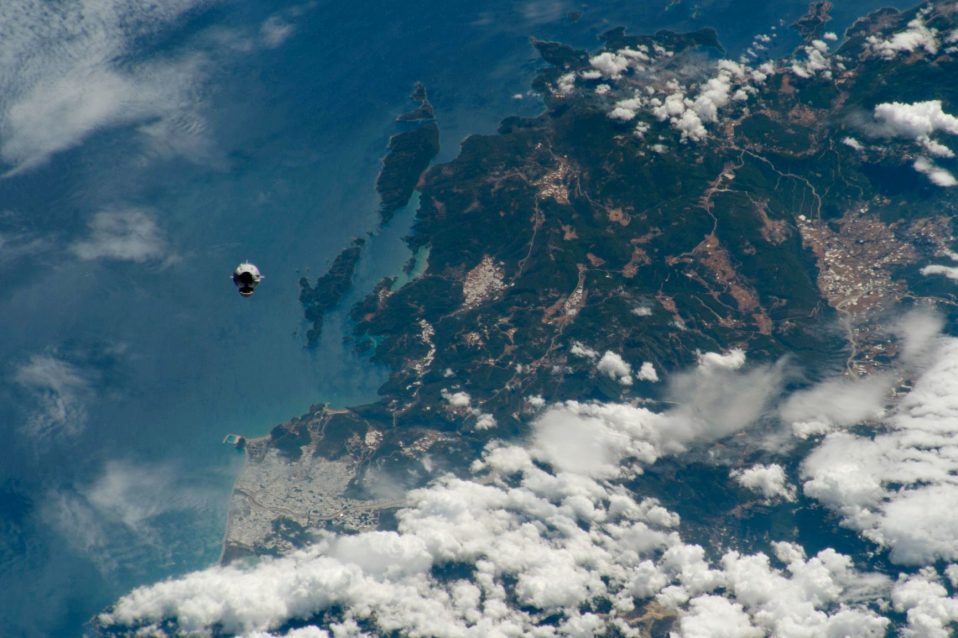 Earth serves as a backdrop for the SpaceX Crew Dragon spacecraft shortly after the Demo-2 launch.